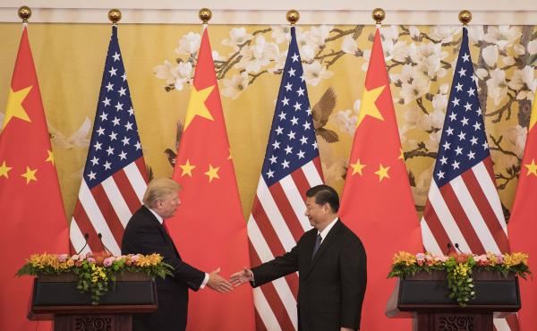 "Chinese President Xi Jinping shakes hands with President Trump during a joint statement in Beijing last November. Rather than a frontal assault on U.S. leadership, Xi has articulated his vision of a ""community of shared destiny."""