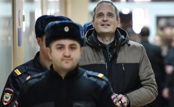 Dennis Christensen, a Danish Jehovah's Witness accused of extremism, is escorted into a courtroom to hear his verdict in the town of Oryol on Feb. 6.