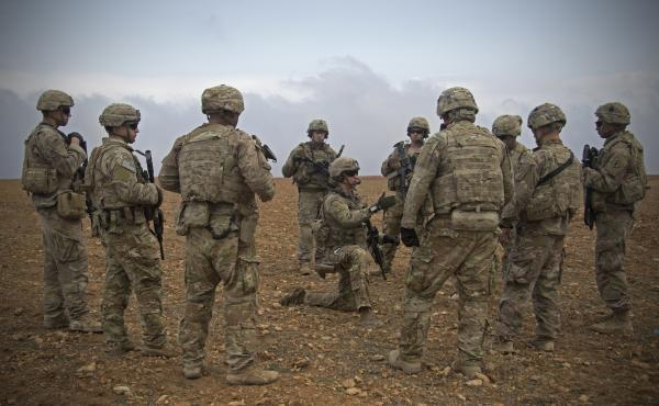 In this Nov. 7, 2018, photo released by the U.S. Army, U.S. soldiers gather for a brief during a combined joint patrol rehearsal in Manbij, Syria.