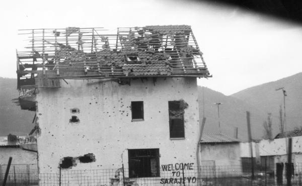 "A damaged building, with graffiti saying ""Welcome to Sarajevo"" on Oct. 2, 1993."