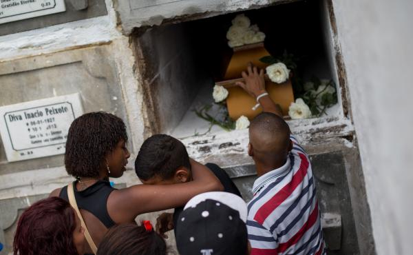 Relatives and friends of Eduardo Felipe Santos Victor, a teenager who was shot dead in Morro da Providencia, a low-income favela community, mourn during his funeral in Rio de Janeiro, on Sept. 30, 2015.