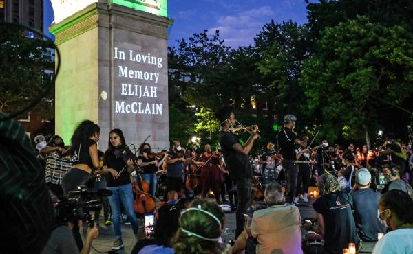 String players perform during a violin vigil for Elijah McClain in Washington Square Park on June 29, 2020, in New York City.