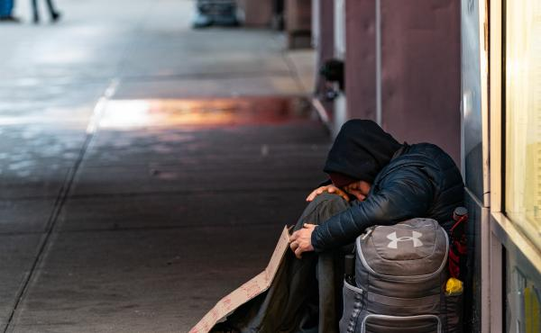 A person sleeps on a sidewalk near New York's Times Square this past week. A new report says more and more American cities are passing laws that make it illegal to sleep outside, on the street, in a park or in your own car.