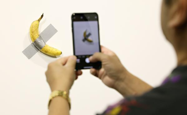 Two editions of Maurizio Cattelan's Comedian, a banana duct-taped to a wall, have reportedly sold for more than $100,000.