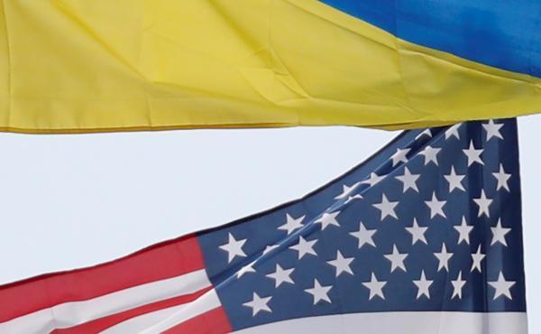 Ukrainian and U.S. flags fly in Kyiv, Ukraine.