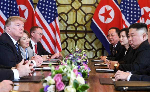 President Trump and North Korea's leader Kim Jong Un (right) hold a bilateral meeting during the second U.S.-North Korea summit in Hanoi, Vietnam, on Thursday.