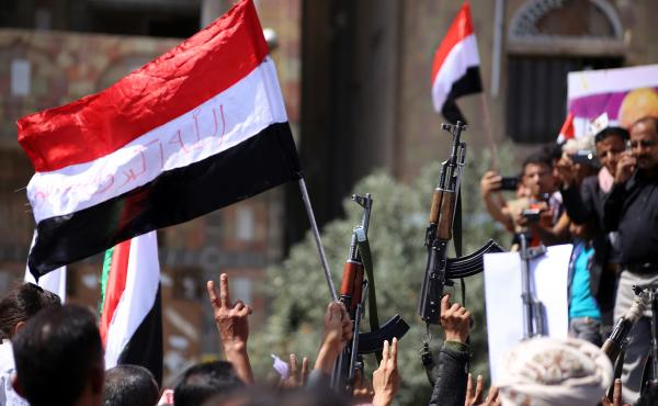 Yemenis wave their national flag during a rally commemorating the anniversary of the 2011 Arab Spring uprising that toppled the then-President Ali Abdullah Saleh, on Feb. 11, 2016, in the southern city of Taez. This year the Middle Eastern country marks t