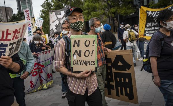 A crowd demonstrates against the Tokyo Olympics earlier this month in Tokyo. With less than three months remaining until the Olympics, concern lingers in Japan over the feasibility of hosting such a huge event during the ongoing COVID-19 pandemic.