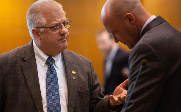 Rep. Mike Nearman, R-Polk County, chats with fellow representatives on the House floor on April 11, 2019, at the Capitol in Salem, Ore. He faces criminal charges after allowing far-right demonstrators to breach the state Capitol in December 2020.