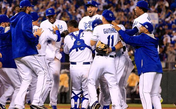 The Kansas City Royals celebrate after defeating the Los Angeles Angels 8-3 to sweep the series in Game 3 of the American League Division Series at in Kansas City, Mo., on Sunday