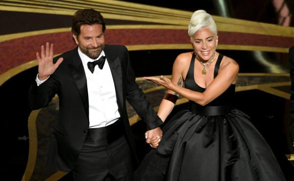 "Bradley Cooper and Lady Gaga address the crowd after performing onstage at the Academy Awards. Their song ""Shallow"" later won the Oscar for original song."