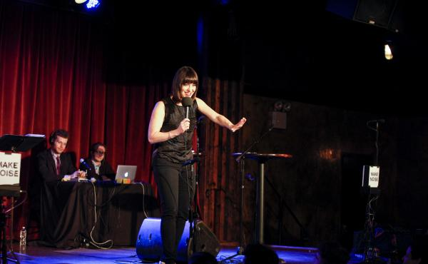 Ask Me Another host Ophira Eisenberg on stage at the Bell House in Brooklyn, New York.