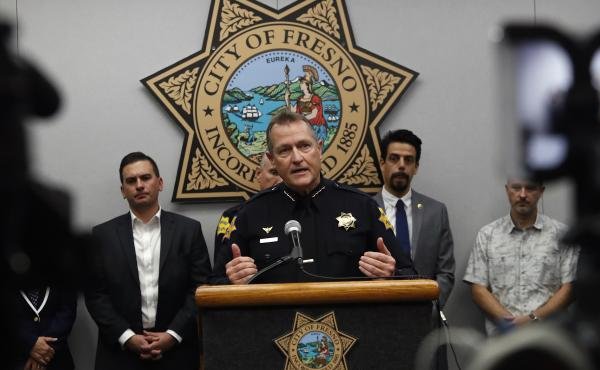 Fresno Police Chief Andrew Hall speaks at a news conference Monday after a mass shooting in which four men were killed and six wounded. All ten were members of Fresno's Hmong community.