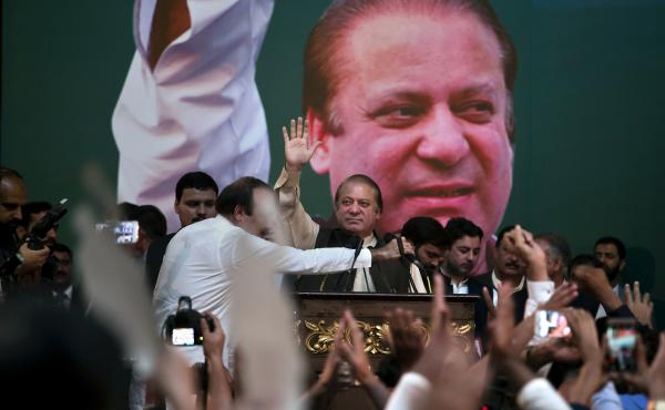 Former Pakistani Prime Minister Nawaz Sharif (center) waves to his Pakistan Muslim League supporters during a party general council meeting in Islamabad this month.