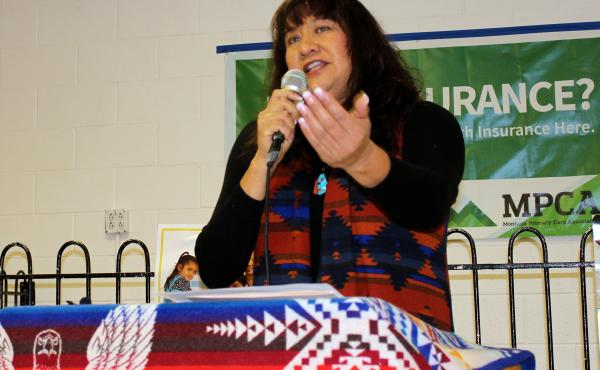 Lee Ann Johnson, director of the Missoula Indian Center, encourages Native Americans in Montana to enroll in private coverage through Healthcare.gov at an outreach event on Saturday, November 15.