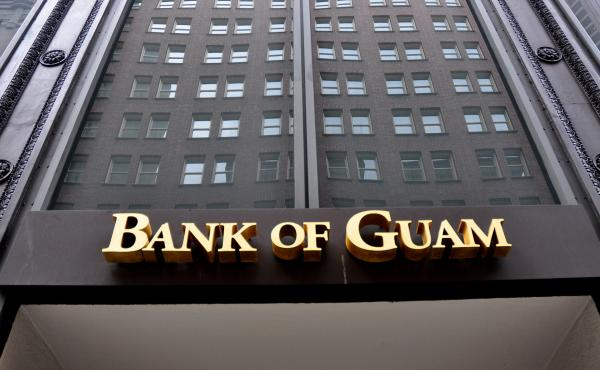 Dozens of people in Micronesia are suing the Bank of Guam for seizing stimulus checks they deposited. The bank did so to help the IRS recover tax payments issued in error.