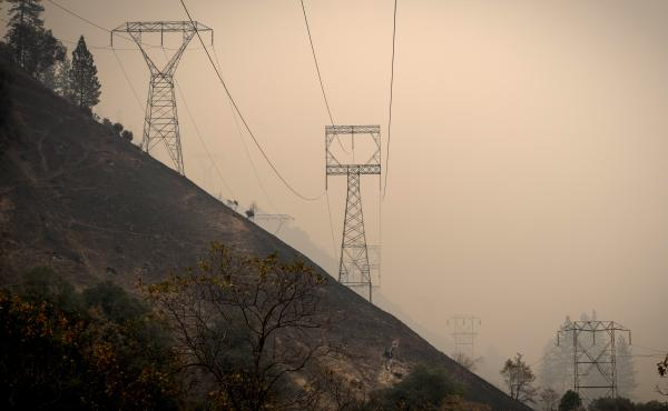 California utility PG&E Corp. said Monday that it plans to file for bankruptcy over what it estimates could be $30 billion in potential liability costs from recent wildfires. Here, transmission towers in a valley near Paradise, Calif., as the Camp Fire bu