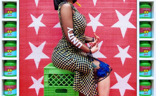 Hassan Hajjaj, born in Morocco in 1961, is often called the Andy Warhol of Marrakesh for his fusion of glamour and everyday life. Both are evident in his 2017 portrait Cardi B Unity. The rap star, dressed in a high-fashion outfit, sits on utilitarian gree