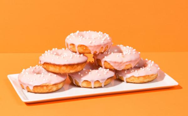 Baked crema Mexicana doughnuts with a blood orange glaze, as featured in the food blog Chicano Eats. On his bilingual blog, Esteban Castillo shares traditional and fusion Mexican recipes. The blog has a stunning, minimalist aesthetic meant to challenge th
