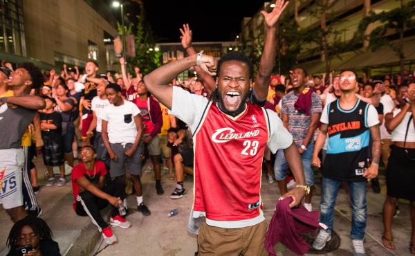 Fans react to a play during the Cleveland Cavaliers NBA Finals Game Seven watch party at Quicken Loans Arena on June 19.