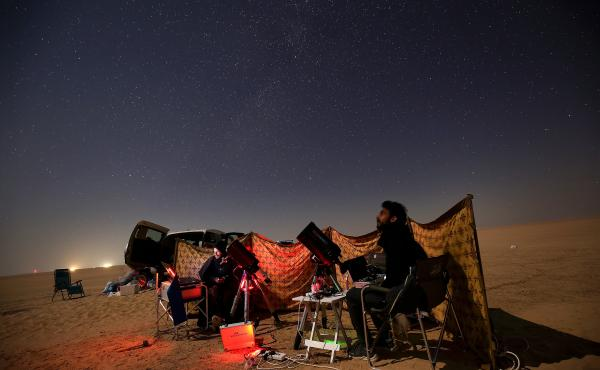Kuwaiti photographers follow the alignment in al-Salmi district, a desert area about 75 miles west of Kuwait City.