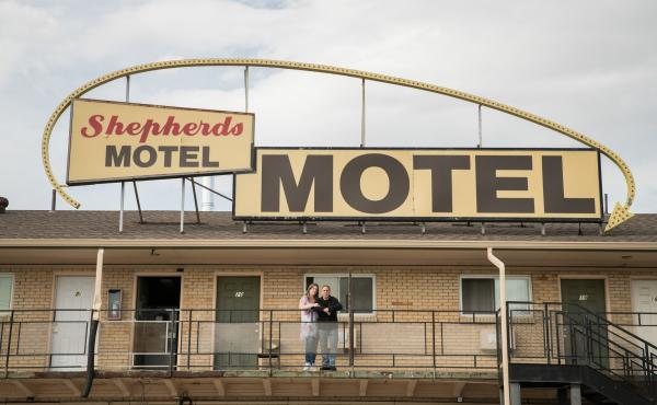 Office manager Shannin Hamilton (left) of the Shepherds Motel in Denver, and Orlando Martinez, co-owner, say that as the coronavirus pandemic begins to cause economic strain in the U.S., the motel's guests have started asking for help paying for rooms.