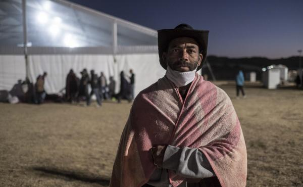 George Baraina Dos Santos, photographed at a camp for the homeless in Standfontein, Cape Town, South Africa. The city's homeless population were broght here by the government as part of the city's corona virus response, but many say they felt safer on the
