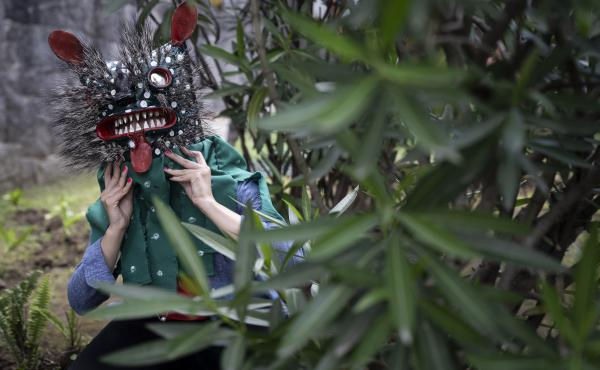 """Blanca Cardenas, professor of ethnology at the National School of Anthropology and History, wears the mask """"COVID Tiger,"""" by Nahua artisan Armando Pascualeño from Zitlala, Guerrero, Mexico."""
