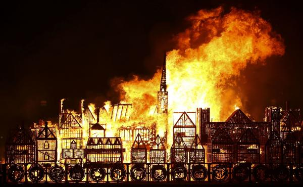A flaming replica of 17th-century London floats on the River Thames on Sunday, part of an event to mark the 350th anniversary of the Great Fire of London.