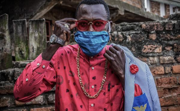 Anglebert Maurice Kakuja, 29, a Sapeur, or Congolese dandy, shows off his fashion sense while wearing a homemade mask in the eastern Congolese city of Bukavu. Sapeurs take their name from the acronym for their group: Societe des Ambianceurs et des Personn