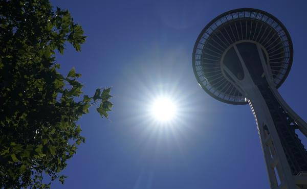 The sun shines near the Space Needle, Monday, June 28, 2021, in Seattle. Seattle and other cities broke all-time heat records over the weekend, with temperatures soaring well above 100 degrees.