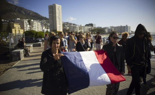 """Hundreds of members of the French community and supporters take part in the """"March of Defiance"""" in Cape Town, South Africa."""