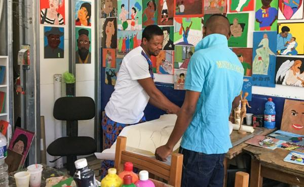 Benjamin Raphael of Nigeria (left) is a salesman who had never picked up a paint brush before he found asylum in Italy.