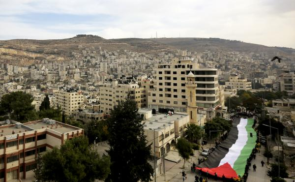 Palestinians held rallies last November, like this one in the West Bank city of Nablus, to mark the 10th anniversary of the 2004 death of Yasser Arafat. Palestinians are increasingly frustrated with the two decades of on-and-off peace talks that have not