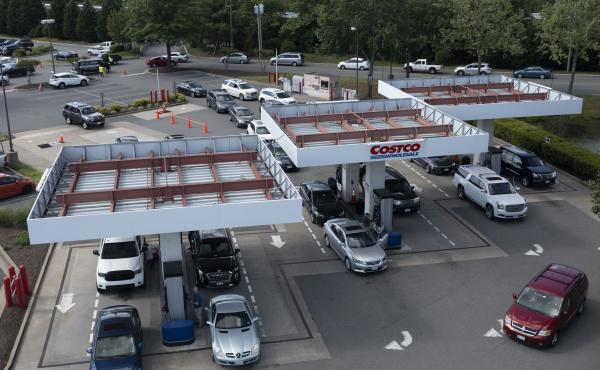 Customers swarm a COSTCO gas station amid fears of a gas shortage in Richmond, Va., Tuesday. The line at the facility extended around the entire building.