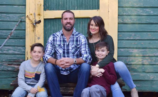Brittany Schwaigert with her husband, Ryan, 13-year-old Greyson (far right) and 10-year-old Lachlan. Schwaigert is a lead plaintiff in a class action lawsuit challenging the Tennessee governor's opt-out policy on masks.