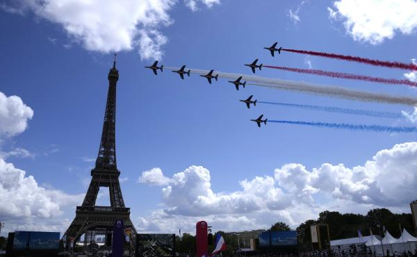 The French Aerial Patrol fly by the Eiffel Tower in Paris as part of the handover ceremony of Tokyo 2020 to Paris 2024, as Paris will be the next Summer Games host in 2024.