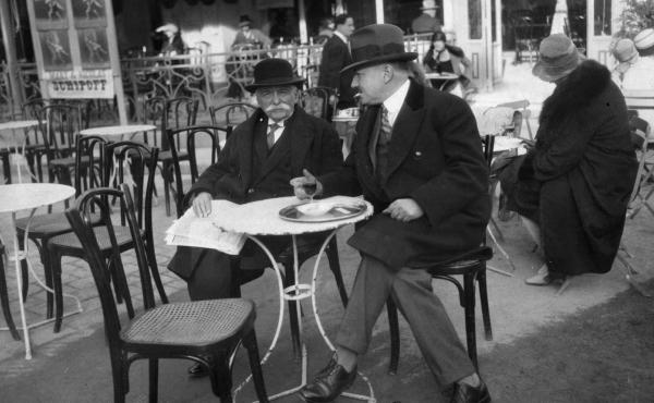 French chef Auguste Escoffier, seen here at a cafe in 1921, helped to found the Ritz Hotel, where Ernest Hemingway was a longtime regular.