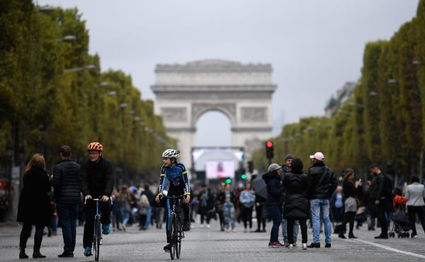 """Mayor Anne Hidalgo has called for an end to gas-powered vehicles in Paris by 2030, in favor of biking, transit, and electric cars. Here, cyclists and pedestrians on the Champs- Élysées during the city's """"day without cars"""" on Oct. 1."""