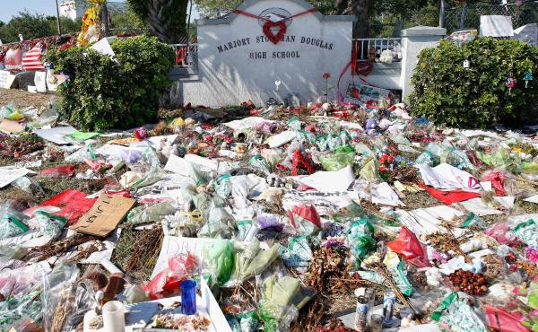 A general view of the makeshift memorial in front of Marjory Stoneman Douglas High School in Parkland, Florida on March 14, 2018.  / AFP PHOTO / RHONA WISE (Photo credit should read RHONA WISE/AFP/Getty Images)