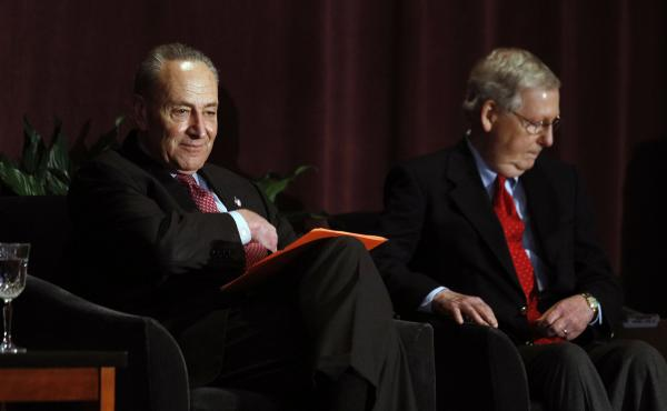 Senate Majority Leader Mitch McConnell, right, and Senate Minority Leader Chuck Schumer wait on stage together at the University of Louisville's McConnell Center before Schumer's scheduled speech last year.
