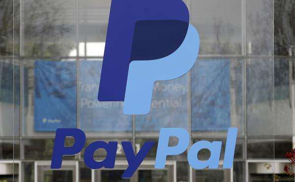 PayPal wrote to a British woman who had died of cancer, saying her death was a breach of contract. The company has since apologized and pledged to find out how it made the mistake.