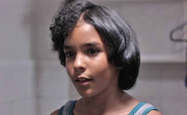 Actor Samuel Lange Zambrano plays Junior, a boy who becomes obsessed with relaxing his hair.