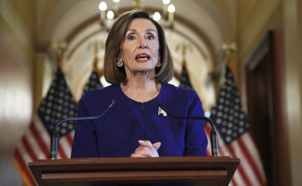 House Speaker Nancy Pelosi reads a statement announcing a formal impeachment inquiry into President Trump on Tuesday.