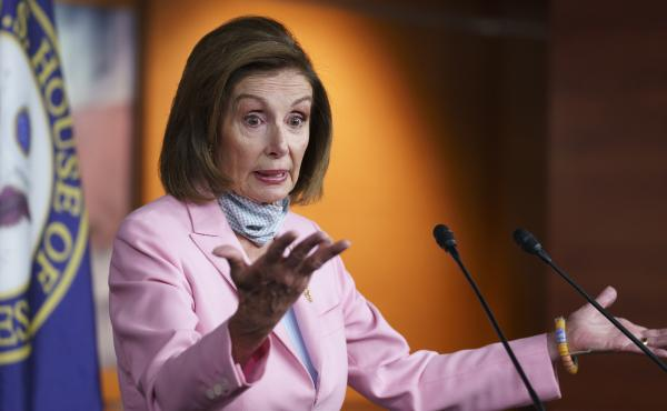 House Speaker Nancy Pelosi speaks at a Wednesday press conference at the U.S. Capitol. Pelosi said lawmakers divert resources from evacuations in Afghanistan by traveling to the region.