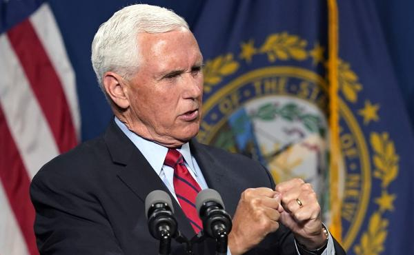 """Former Vice President Mike Pence addresses the annual Hillsborough County Lincoln-Reagan Dinner on Thursday night in Manchester, N.H. He called Jan 6 """"a dark day"""" in the history of the U.S. Capitol."""