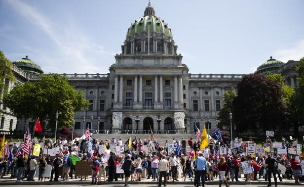 Protesters demonstrate during a rally against Pennsylvania's stay-at-home order at the state Capitol in Harrisburg, May 15. While the public is temporarily banned from the capitol due to the coronavirus outbreak, lawmakers, including one who recently test