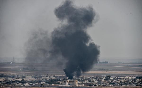 Smoke rises from the Syrian town of Ras al-Ain on Friday amid Turkey's military operation against Kurdish forces.