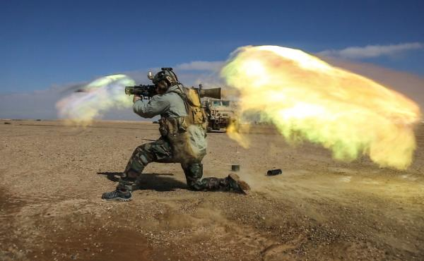 A soldier fires a Carl Gustav recoilless rifle system during weapons practice in Helmand province, Afghanistan. Heavy weapons like these generate a shock wave that may cause brain injuries.