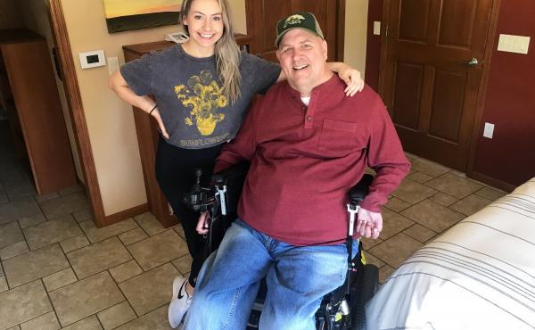 Matt Ford is seen in Verona, Wis., with one of his caregivers, Grace Brunette. An accident in 1987 left Ford paralyzed in all four limbs. He needs help getting in and out of bed, preparing meals, using the bathroom and driving. Brunette recently finished